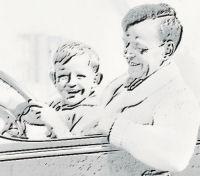 dad and boy in car