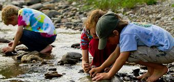 Camping kids in stream